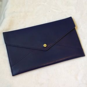 Royal blue clutch with gold details